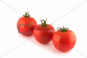Three red tomatos