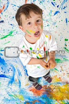 Boy playing with painting