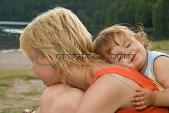 Smeary daughter hugging mother