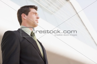 Businessman standing outside office