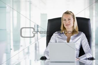 Female executive at desk