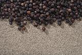 black peppers whole and ground on background