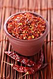 Hot Red Chilli Chillies crushed pepper in teracotta pot