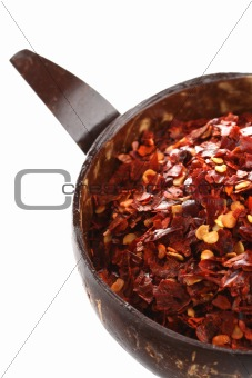 Spices  Hot Red Chilli Chillies pepper crushed in coconut bowl