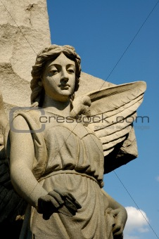 Solemn Female Angle with Wings on Granite Cross
