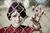 Punk Girl Behind Chain Link