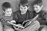 Three Boys Reading