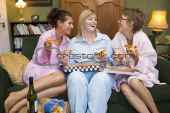 3 girlfriends at home eating pizza