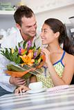 Man giving woman bouquet of flowers