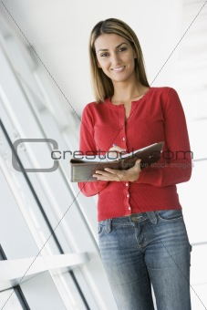 Businesswoman taking notes in office