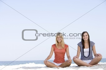 2 Girlfriends relaxing on beach