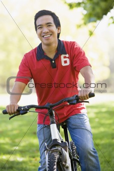Asian man riding bike in the park