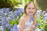 Young girl in bluebell wood