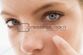 Close up of woman putting on make up