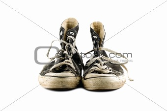 Old grungy sneaker isolated on white background