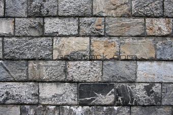 Old grunge stone wall ,close up photo