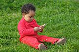Baby playing on the grass