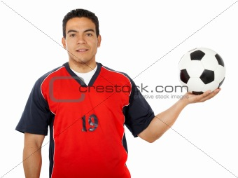 male footballer holding a football