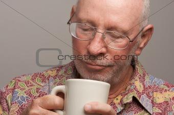 Senior Man Enjoys His Coffee