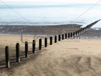Posts on a beach
