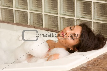 Attractive young gorges female taking bath