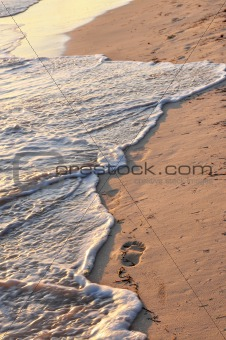 Tropical beach with footprints