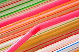 Multi-coloured straws for a cocktail