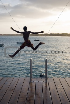A boy jumps for joy.