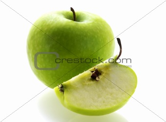 green fresh ripe apple with a slice