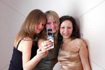three attractive young women photographed by phone