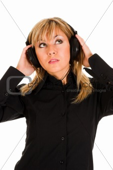 beautiful young woman listening music in headphones