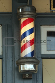 Old barber pole on a building