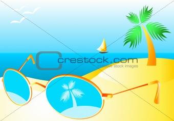 Sun-glasses at the sand of sunny beach interior