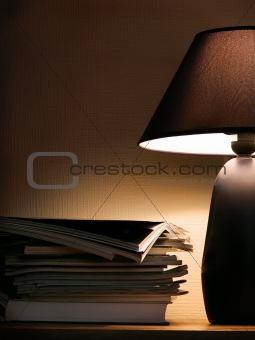 Magazines under evening lamp light