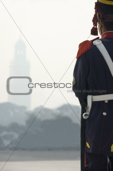 Soldier looking through the mist