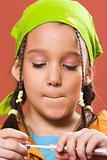 child applying make-up