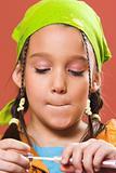 child applying make-up