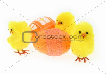 three toy chickens with decorated eggs