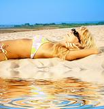 tanning blonde in sunglasses