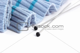 knitting needles with blue sweater