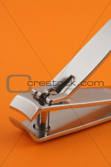 nail clippers on orange