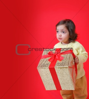 Toddler with a christmas gift