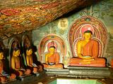 Statues of Lord Buddha & paintings in an ancient temple
