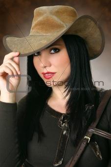Beautiful cowgirl wearing hat