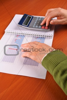 Business woman calculating