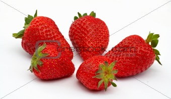 Five Strawberries, focus on the strawberry in front. On white ba
