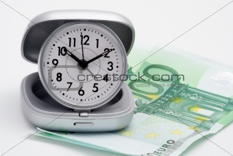 Clock and money (euros)