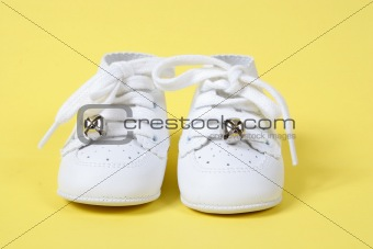 Baby Shoes on Yellow background