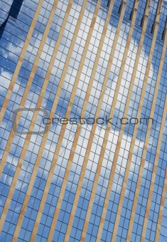 Clouds reflected into building