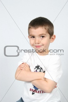 Boy with arms folded
